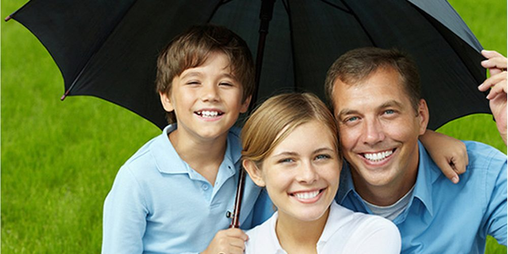 family under an umbrella